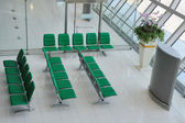 Chairs in departure hall — Stock Photo