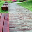 Stock Photo: Benches by wooden road