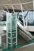Glass elevator and escalator — Stock Photo