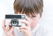 Young boy with retro camera — Stock Photo