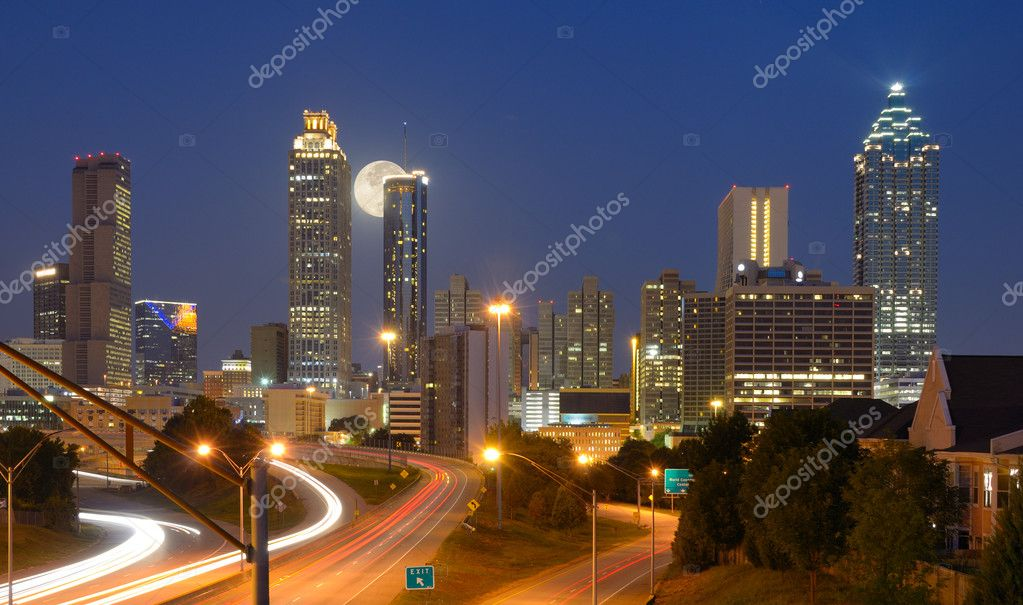 Skyline of downtown Atlanta, Georgia from above Freedom Parkway with a full moon.  Stock Photo #6862420