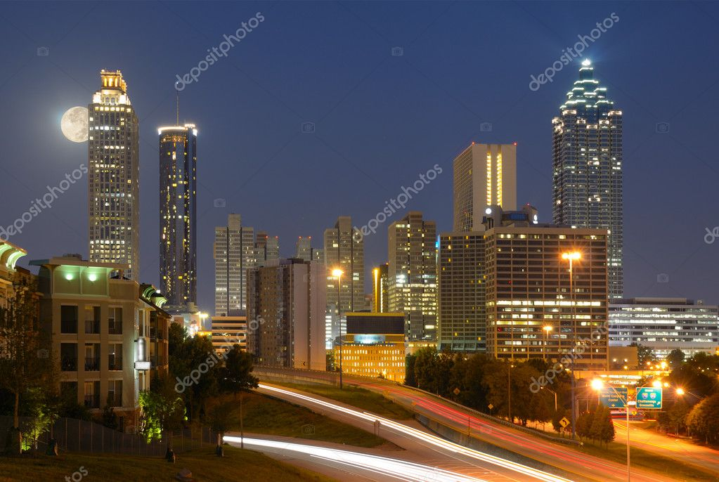 Skyline of downtown Atlanta, Georgia from above Freedom Parkway with a full moon.  Stock Photo #6862427
