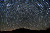 Star Trails above a Mountain — Stock Photo