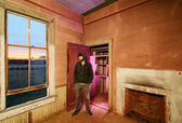 Man in abandoned house — Stock Photo