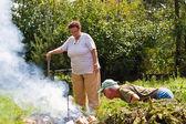 Senior couple making a bonfire — Stock Photo