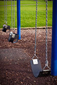 Kids playground swing detail — Stock Photo