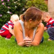 Mother with children enjoy garden — Stock Photo