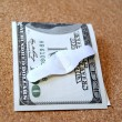Stock Photo: Americdollar bill with band aid