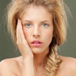 Studio portrait beautiful blonde woman blue eyes — Stock Photo #6836567