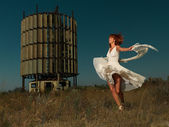 Fashion portrait woman twirling in white dress — Stock Photo
