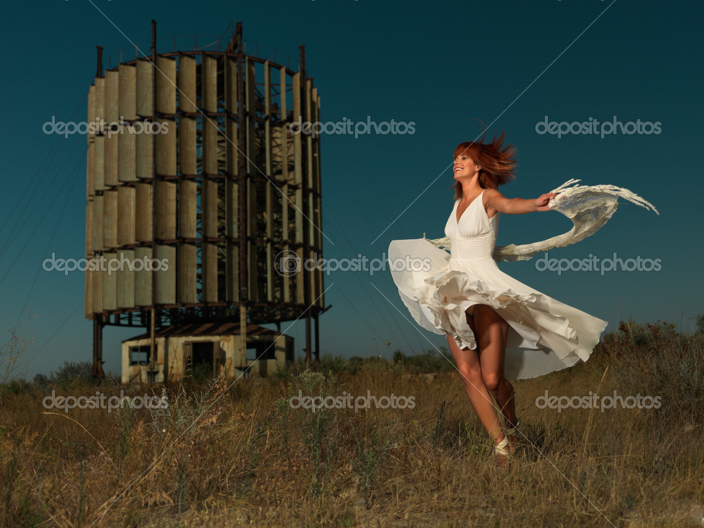 Happy woman dancing near an old windmill — Stock Photo #6835562