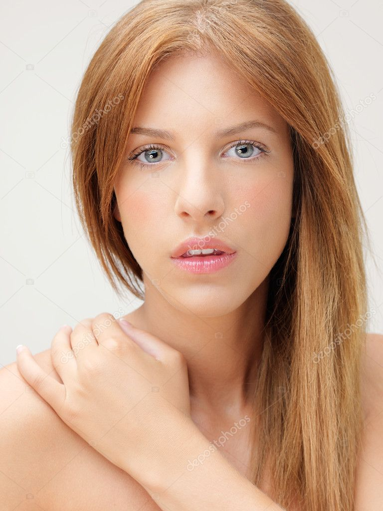 Beauty portrait woman with hand on shoulder — Stock Photo #6835626