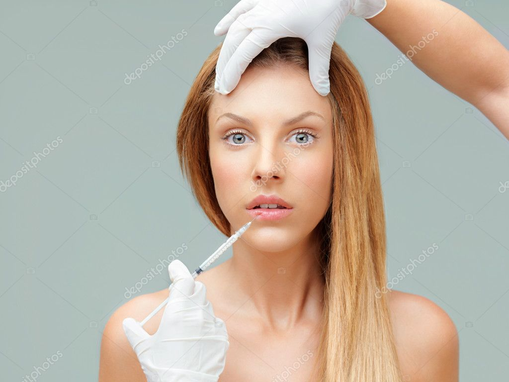 Beautiful young woman having colagen injection lips — Stock Photo #6835814