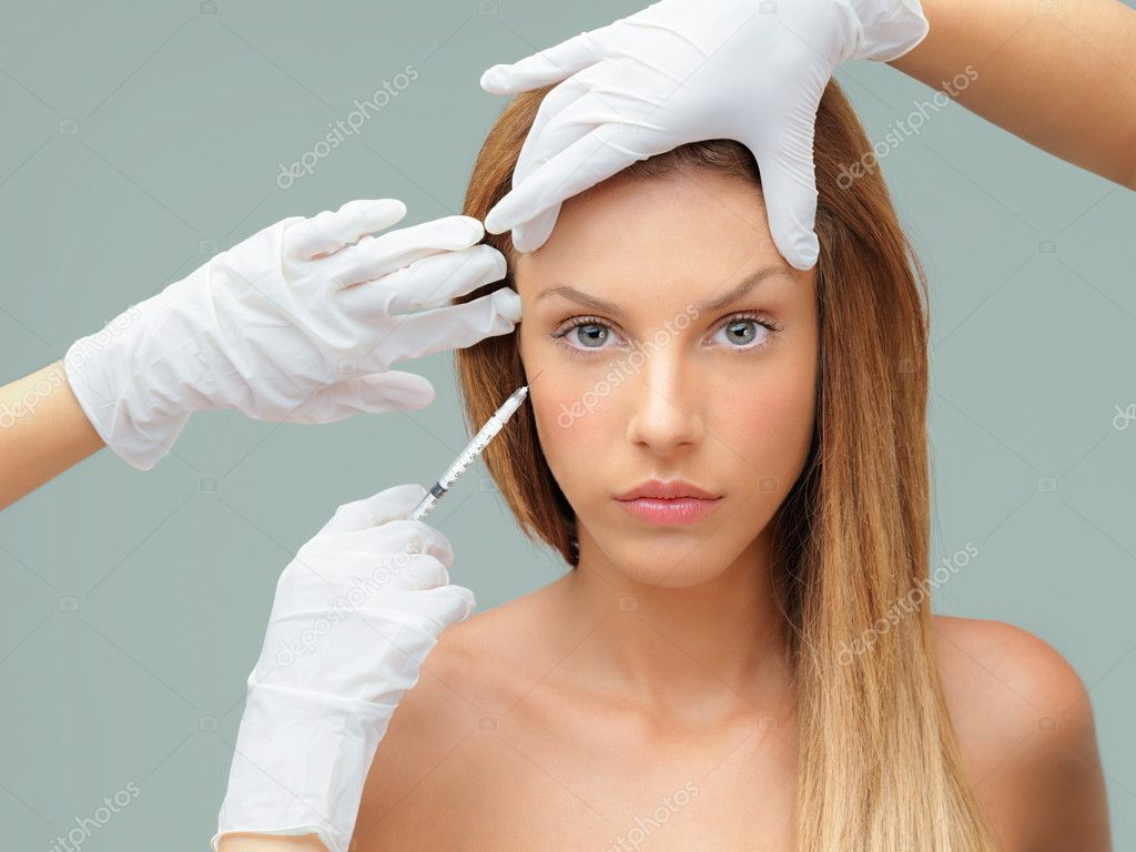 Beautiful young woman botox injection eye area  Stock Photo #6836015