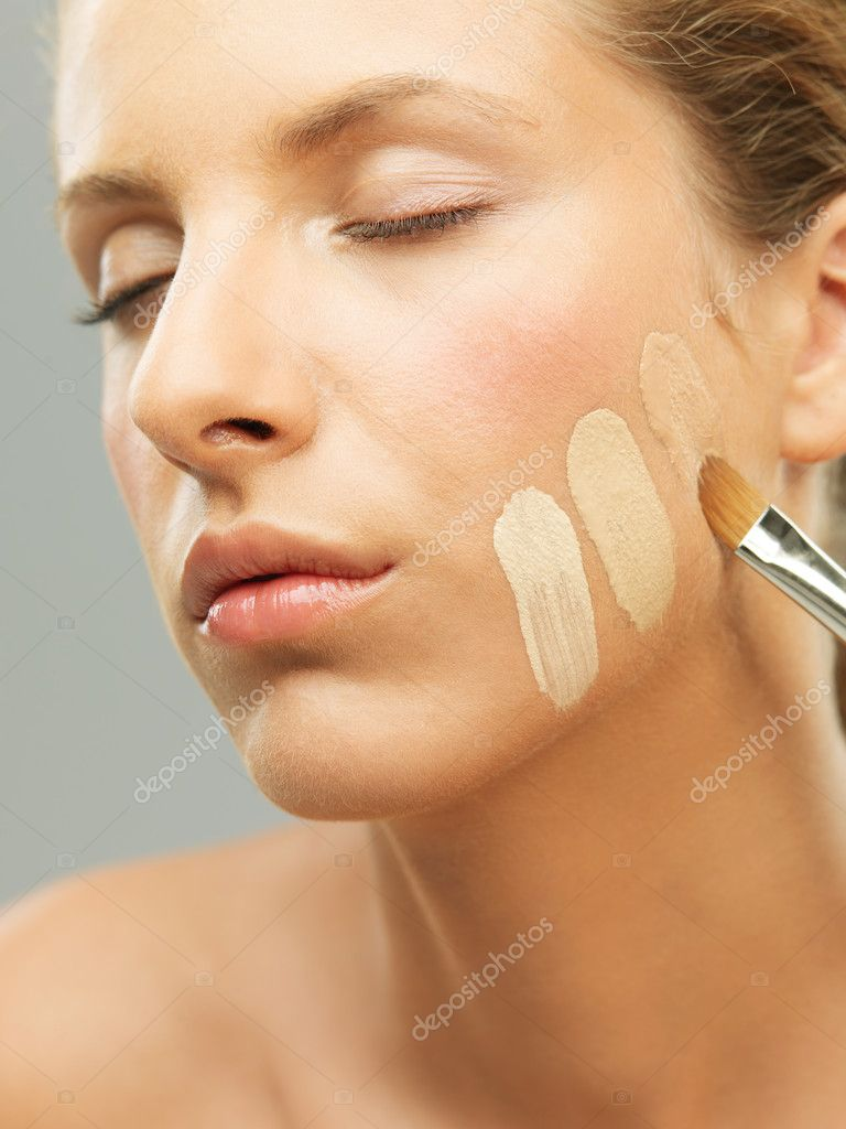 Closeup portrait woman trying different shades foundation — Stock Photo #6837081