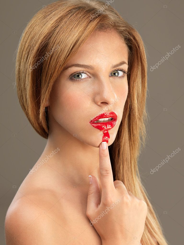 Beauty portrait sexy woman smudging red lipstick — Stock Photo #6837103
