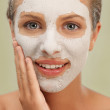 Closeup beauty portrait woman with facial mask — Stock Photo #7279430