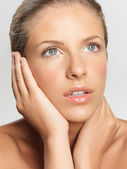 Closeup beauty portrait of young woman — Stock Photo