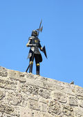 Knight in armour sky blue on a wall in the Old Rhodes Town in Gr — Stock Photo