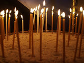 Candles in the sand in church, Greece — Stock Photo