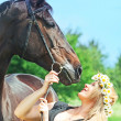 Beautiful women and  her mare - Photo