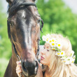 Kiss of beautiful women to her mare - Photo