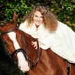 Portrait of beautiful bride with  horse - Photo