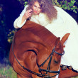 Soft portrait of beautiful young bride with  sorrel horse - Stock Photo