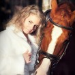 Stock Photo: Portrait of beautiful bride with horse
