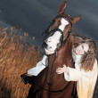 Portrait of beautiful bride siting on red  horse at nigth - Stock Photo