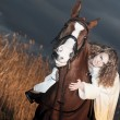 Portrait of beautiful bride siting on red horse at nigth — Stock Photo