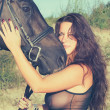 Portrait of sexy women with black  horse — Stok fotoğraf