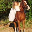 Bride ride on red horse — Stock Photo