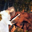 Bride ride with red horse — Stock Photo