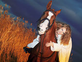 Bride ride on red horse at night — Stock Photo
