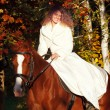 Nice smiling young bride on  horse — Stock Photo
