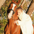 Portrait of nice young bride with horse — Stock Photo #7794016