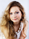 Girl of slavic appearance with a long fair hair — Stock Photo