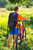 Man cyclist with bike and backpack — Stock Photo