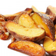 Potato wedges roasted in their skins - Stock Photo