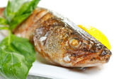 Grilled juicy pikeperch with lemon and basil — Stock Photo