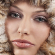 Girl with fur around her face — Stock Photo #6765364