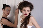 Beautiful girls in black and white dress — Stock Photo