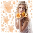 Curly blond girl with orange lily — Stock Photo #6840528