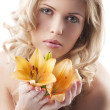 Blond curly woman holding lily — Stock Photo #6840752