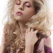 Beautiful woman with long curly blond hair and makeup — Stock Photo