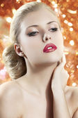 Blond woman with redgolden lips — Stock Photo