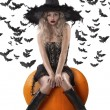 Sensual witch dressed in black - Stock Photo