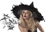 Portrait of a cute and sexy witch — Stock Photo