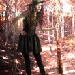 Pretty and cute witch with broom inside a forest — Foto Stock